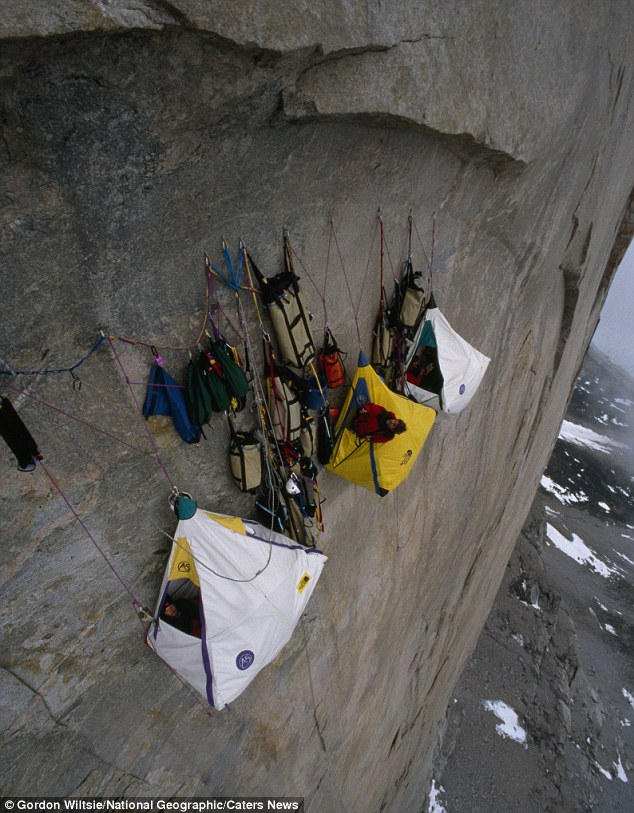 Hanging around: Three tents are suspended off a 4,000ft vertical cliff in the Arctic as climbers get some much needed sleep