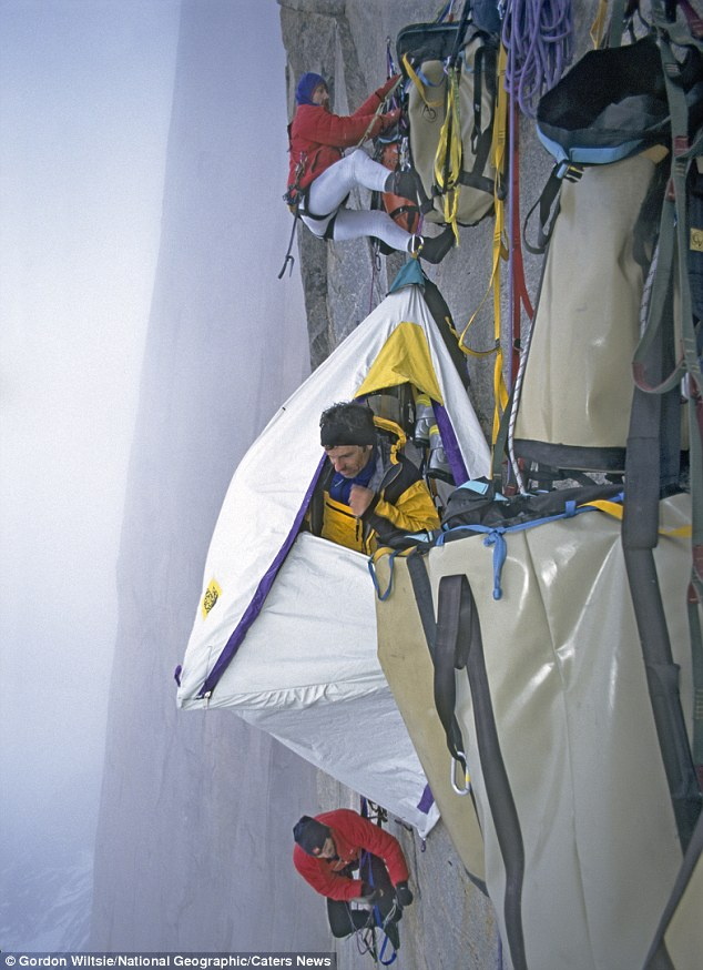 Home comforts: Jon Catto, Greg Child and Mark Synnott set up their Portaledge camp site, complete with baggage, at 4,000ft