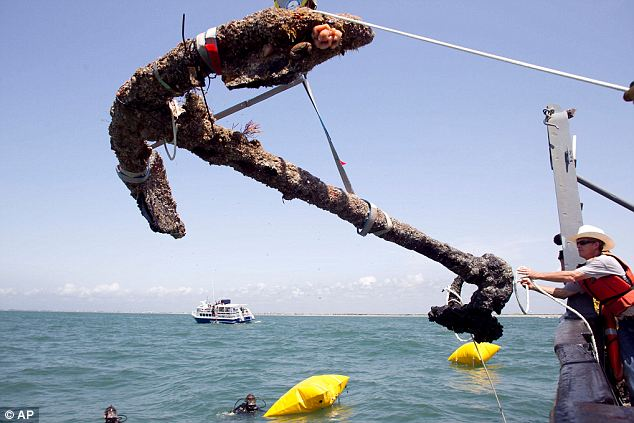 Raised: A 3,000 pound anchor from what is believed to be the wreck of the pirate Blackbeard's flagship, the Queen Anne's Revenge has been recovered