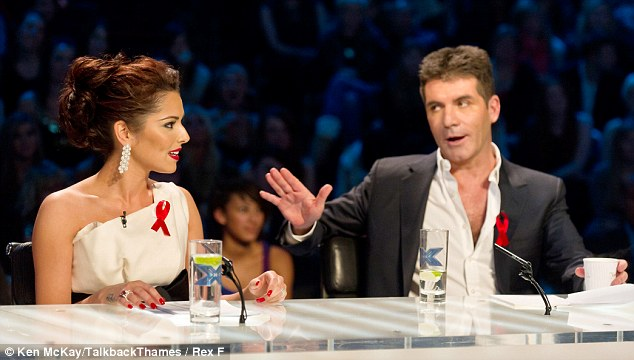 Back-up offer: Cheryl Cole is said to be furious with Cowell and plans to snub his offer of her old job on UK X Factor