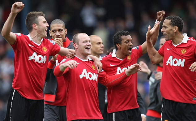 Michael Carrick pictured with his United team mates after clinching the Premier League title
