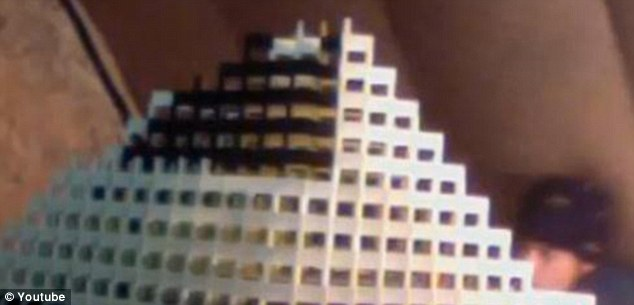 Wobble: The domino fanatic doesn't notice a slight shuffling from above until it's too late