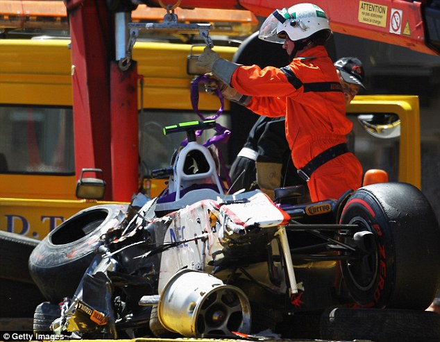Wheel gone kid: There isn't much left of Perez's sauber but a mass of twisted metal