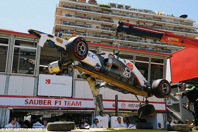 Wrecked: Perez's car is hoisted from a truck