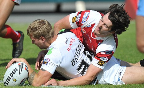 Five star: Bulls' Kyle Briggs scores his sides fifth try