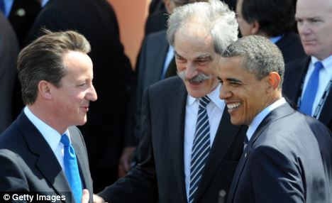 The British donate more to humanitarian causes than anyone else in Europe: David Cameron with U.S. President Barack Obama and acting Director General of the IMF John Lipsky at the G8