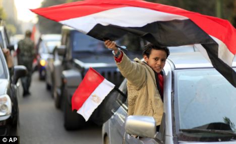 Egyptian celebration: The Prime Minister has announced plans to funnel £110million of taxpayers' cash to Egypt, Tunisia and Middle Eastern countries to develop democracy after the so-called 'Arab Spring'
