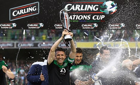 Champions: Robbie Keane lifts the Carling Nations Cup