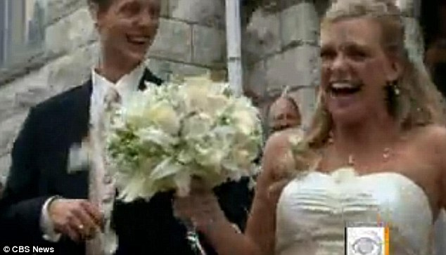 Happy couple: Their guests told them a wedding would have the opposite effect and bring a much needed ray of hope