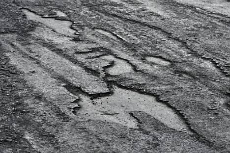 Holy moly: Potholes have taken over this street in Doncaster, South Yorkshire