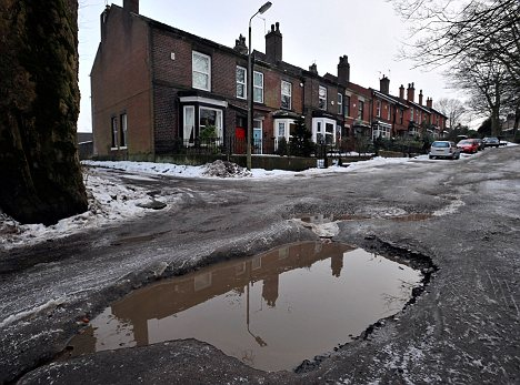 Cold snap: Freezing weather frequently sees an increase in the number of potholes, like these in Bury, Lancs