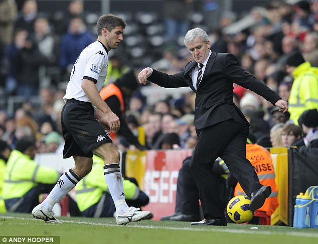 Marked man: Fulham manager Hughes (right) is wanted by Aston Villa to replace Gerard Houllier
