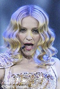 Old hand: Madonna performing with white locks