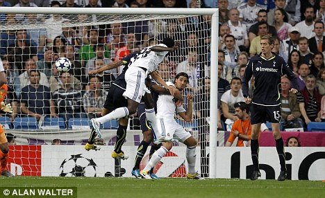 On the mark: Adebayor (centre) scord five goals during his five month stay at the Bernabeu