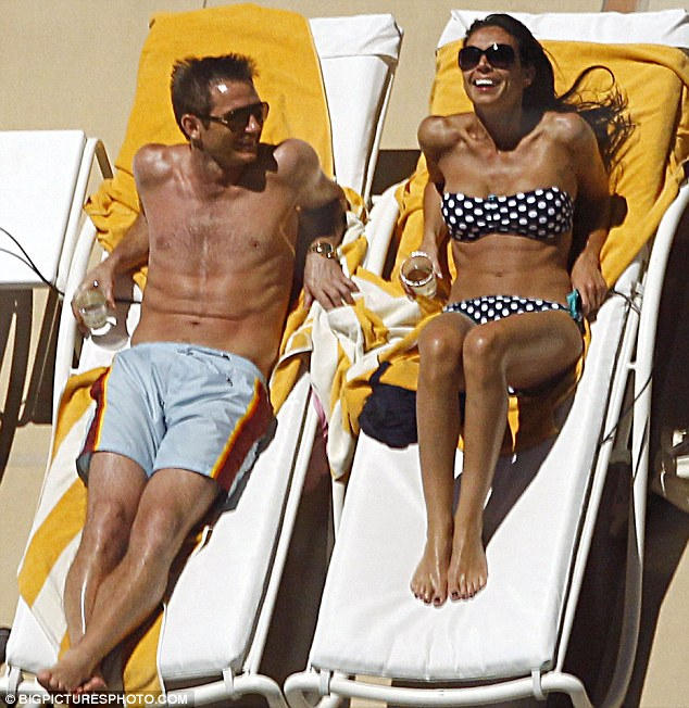 Romantic rendezvous: The pair were pictured sharing a laugh last week as they basked in the sun at their hotel