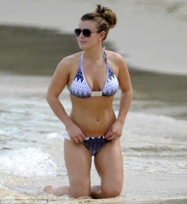 Winning wife: Coleen stole the show on the beach... well, she has been to Barbados lots this year!