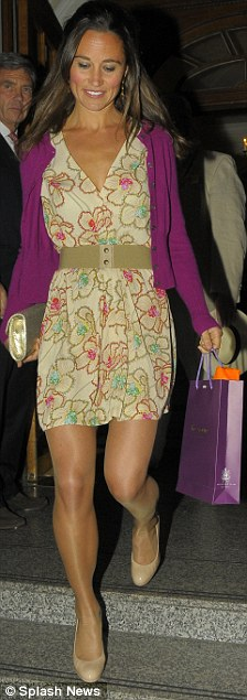 Chic: The Duchess of Cambridge's sister looked great in her floral patterned dress and purple cardigan