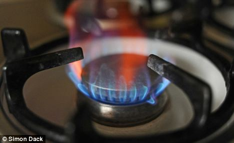 A gas flame on a kitchen cooker . Home energy and fuel prices including gas and electricity  are expected to rise in price by up to 30% in the UK
