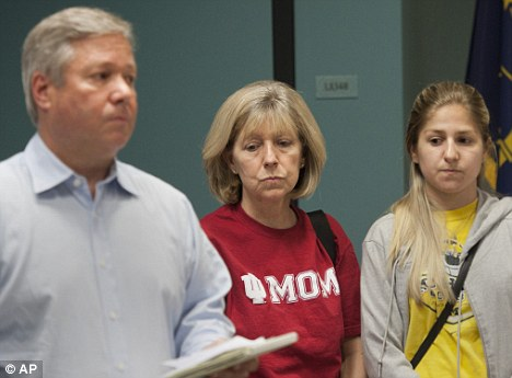 Anxious: Lauren's parents, Robert and Charlene, and her sister Rebecca, have made an emotional appeal for the safe return of their daughter and sister