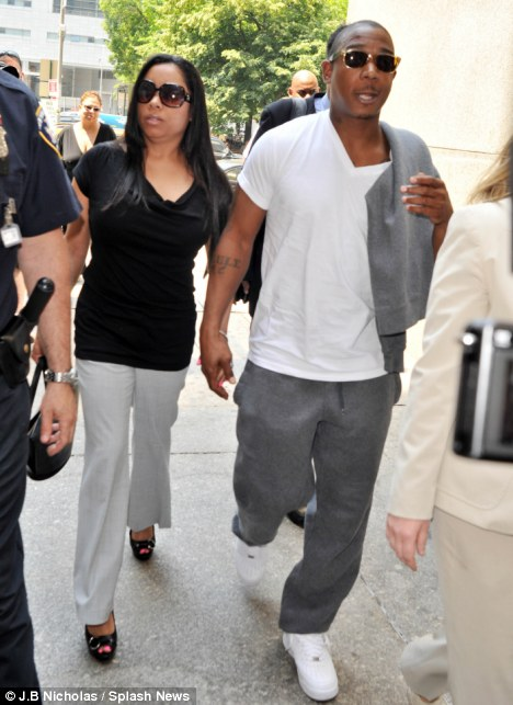 Final moments of freedom: Ja Rule arrived at court today holding hands with his wife of ten years, Aisha Atkins