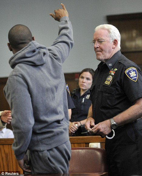 Good spirits: The rapper waved to fans in the courthouse before being led off.