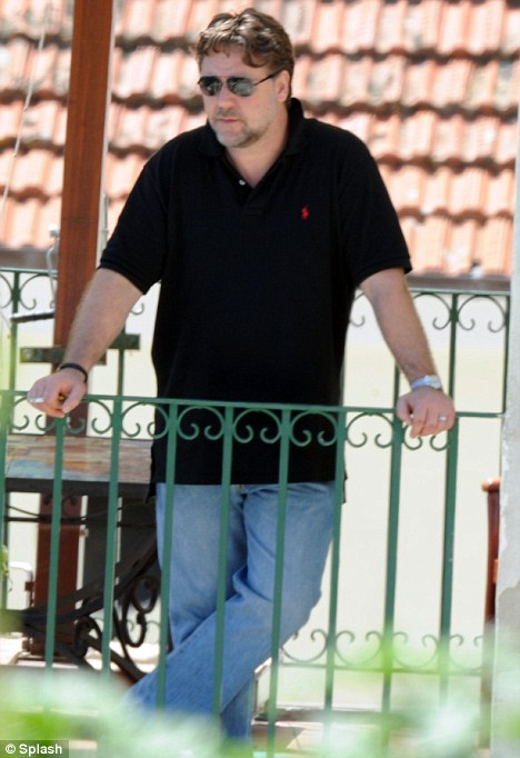 Controversy: Russell Crowe, pictured in Italy on Wednesday, hit out at the practice of circumcision on Twitter