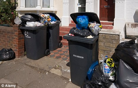 Uncollected: Weekly rubbish collections will not return after Government Ministers chose to give up the battle to reinstate them
