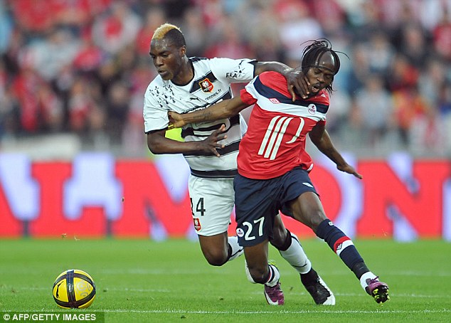 Tough choice: Arsenal and Spurs are chasing Lille forward Gervinho (right)