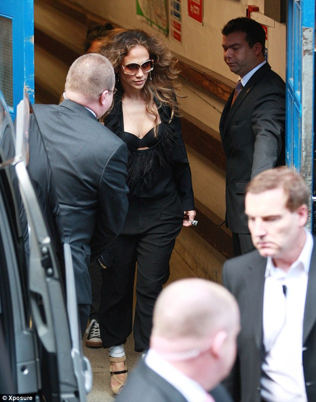 Sneaking out the back door: The star was wearing an all-black ensemble and sunglasses