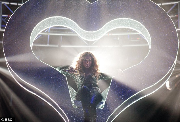 Jenny from the block: The star made her entrance being lowered down onto the stage in a giant illuminated heart