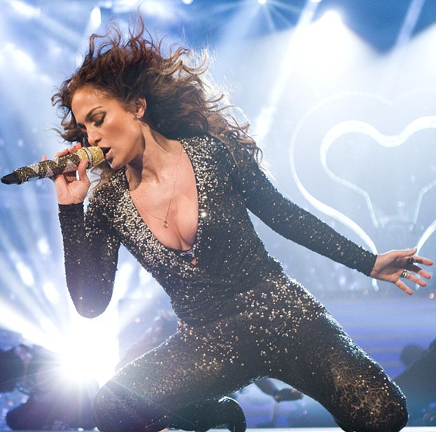Saucy: Jennifer Lopez flashed her bra and brandished her bottom in a tight sparkly catsuit on So You Think You Can Dance tonight