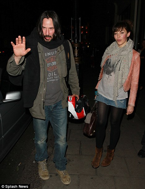New leading lady: The 46-year-old actor seemed camera shy to be spotted with the pretty brunette