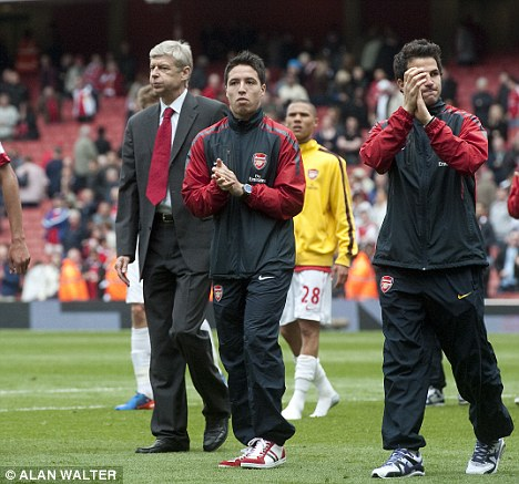 Don't go: Arsene Wenger (left) wants Samir Nasri (centre) to stay with Arsenal