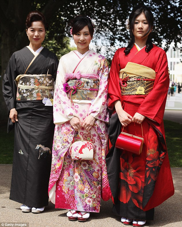 Culture shock: Three Japanese racegoers arrive in traditional Japanese dress