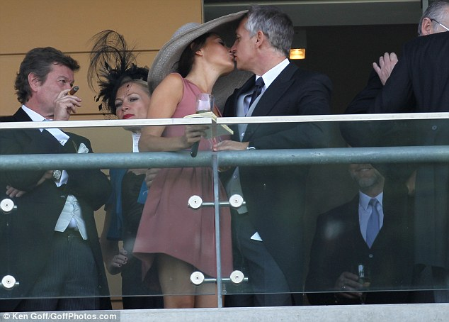 Private moment:The couple share a kiss on the balcony