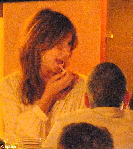 Pucker up: Getting her lips ready for some affectionate action, Elisabetta coated her pout with a slick of lip-gloss before the couple left the table