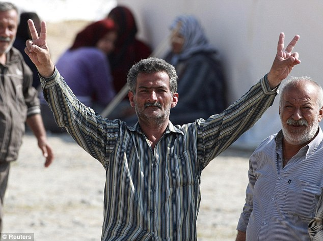 Defiance: A Syrian refugee in the camp in the Turkish border town of Boynuegin