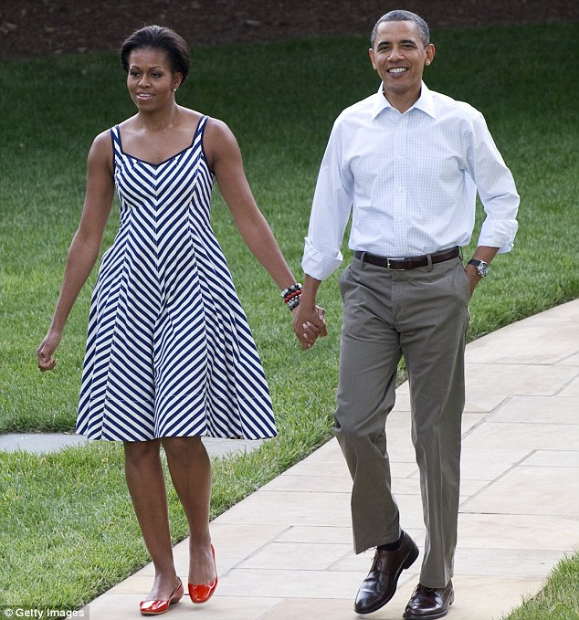 By night: The First Lady arrives with her husband for the Congressional Picnic on the South Lawn of the White House