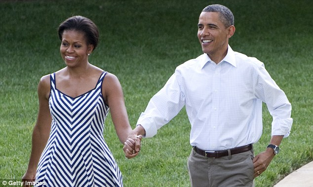Laid back: The Obamas do casual chic as they stroll hand in hand towards their guests at the family picnic