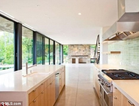Spacious: The property's open-plan kitchen seems to stretch as far as the eye can see