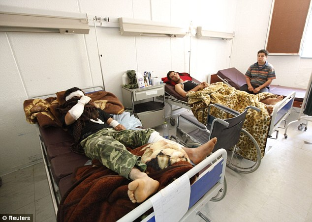 Casualties of war: Rebel fighters injured during fighting on the frontline arrive at the hospital in Riyayna