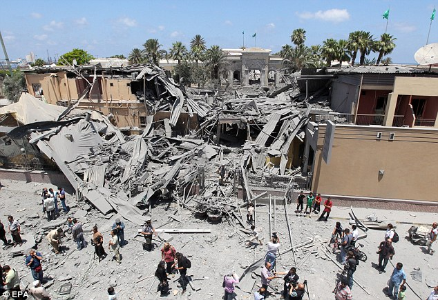 Blown away: Little remains of the Wenzrik Hotel which, according to the Libyan authorities, was hit by a Nato airstrike in the early hours of this morning