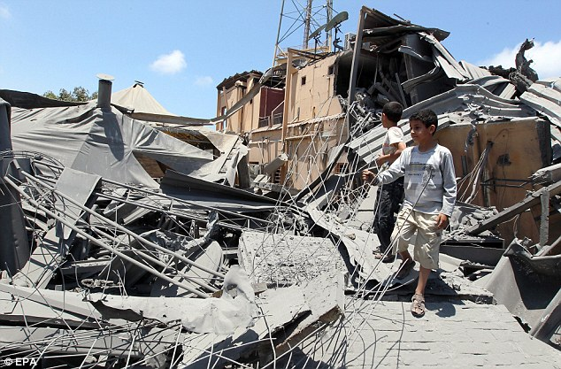 Bomb site: Children inspect the rubble of the bombed hotel