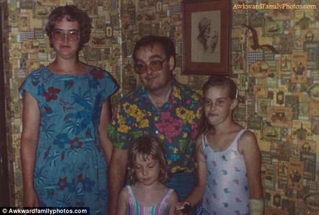 Different designs: It's no surprise the little girl is closing her eyes as this wallpaper colour clash is horrific