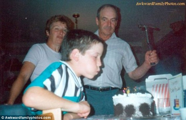 Hammer home: If this boy couldn't blow out the candles, his father could always have finished the job