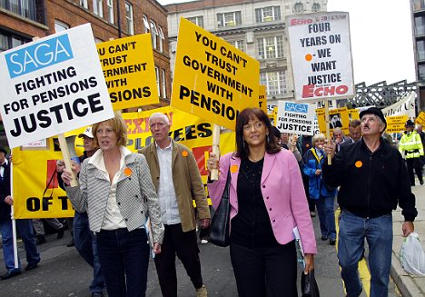 Different way: Dr Ros Altmann, pictured here in pink jacket leading a pensions protest in Manchester in March, said the current plans were unfair and could even be illegal