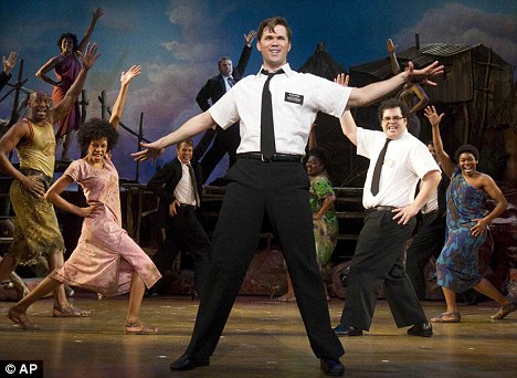 Smash hit: A scene from the Book of Mormon, a musical about two naive missionaries who travel from Utah to Uganda to preach