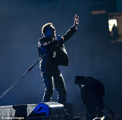 Emotional: Bono dedicated the group's final song to E Street Band saxophonist Clarence Clemons, who died Saturday