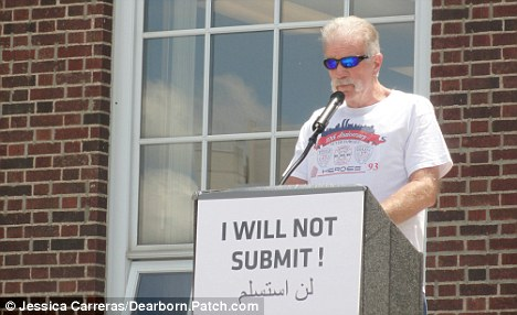 At the podium: Controversial pastor Terry Jones leads the rally outside city hall in Dearborn, Michigan