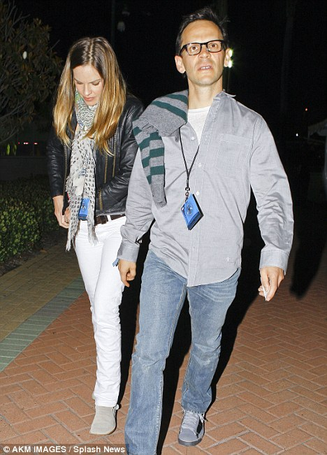 More star guests: Hilary Swank and her partner John Campisi head into the U2 concert in California